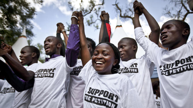 """Supporters of Kenyan presidential candidate Raila Odinga attend the launch of their campaign of social media protest and prayer vigils entitled """"Democracy on Trial"""", which is due to last until the country's highest court has ruled on petitions challenging the validity of the recent election, in Nairobi, Kenya, Friday, March 15, 2013. Odinga has said he will challenge the result of the recent elections in the courts, alleging widespread irregularities, and that lawyers for his party will file a petition to the Kenyan Supreme Court by the end of the week. (AP Photo/Ben Curtis)"""