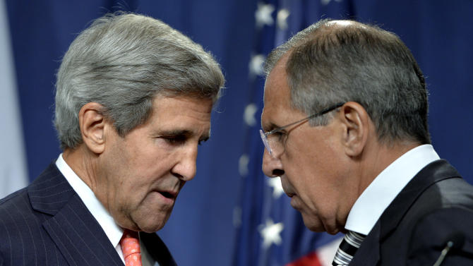 U.S. Secretary of State John Kerry, left, speaks with Russian Foreign Minister Sergei Lavrov, right, during a news conference in Geneva, Switzerland, Saturday Sept. 14, 2013. U.S. Secretary of State Kerry and Russian Foreign Minister Lavrov said Saturday they have reached an agreement on a framework for Syria to destroy all of its chemical weapons, and would seek a U.N. Security Council resolution that could authorize sanctions, short of military action, if Syrian President Bashar Assad's government fails to comply. (AP Photo/Keystone,Martial Trezzini)