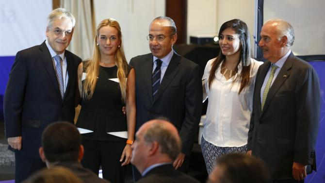 Former presidents Sebastian Pinera from Chile, Felipe Calderon from Mexico and Andres Pastrana from Colombia pose for a picture with Lilian Tintori and Patricia Ceballos  in Caracas