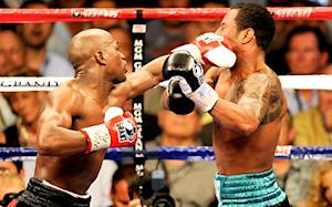 Mayweather mauls Mosley; must meet Manny