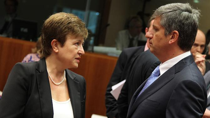 European Commissioner for International Cooperation, Humanitarian Aid and Crisis Response Kristalina Georgieva, left, talks with Austrian Foreign Minister Michael Spindelegger, prior to the start of an EU foreign affairs meeting at the European Council building in Brussels, Monday, July 23, 2012. The European Union foreign chief says the escalating bloodshed in Syria was sparking concerns that the conflict may spill over into neighboring countries. (AP Photo/Yves Logghe)
