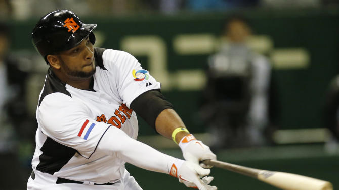 Netherlands' rightfielder Wladimir Balentien gets struck out off Japan's starter Kenta Maeda in the fourth inning of their World Baseball Classic second round game at Tokyo Dome in Tokyo, Sunday, March 10, 2013. (AP Photo/Koji Sasahara)