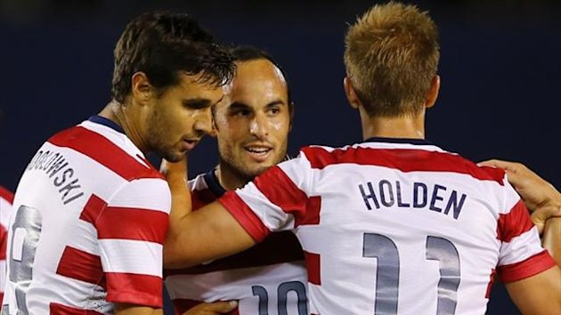 US forward Landon Donovan (C) celebrates his second goal of the game against Guatemala with teammates Chris Wondolowski (19) and Stuart Holden (11) during their friendly soccer match in San Diego (Reuters)