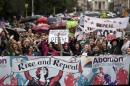 Demonstrators take part in a protest to urge the Irish Government to repeal the 8th amendment to the constitution, which enforces strict limitations to a woman's right to an abortion, in Dublin