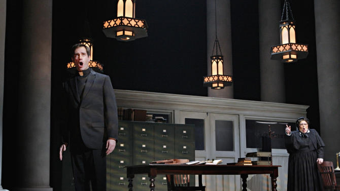 "In this Jan. 23, 2013 photo provided by the Minnesota Opera, Matthew Worth as Father Brendan Flynn, a parish priest and Christine Brewer as Sister Aloysius Beauvier, the school principal, perform during a dress rehearsal for the Jan. 26 world premiere of ""Doubt"" at the Minnesota Opera Center in Minneapolis. (AP Photo/Minnesota Opera, Michal Daniel)"