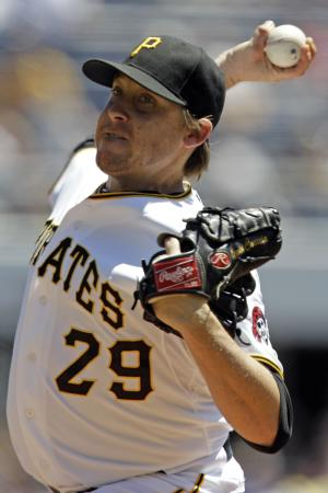 Pittsburgh Pirates pitcher Kevin Correia delivers in the second inning of a baseball game against the Chicago Cubs in Pittsburgh, Wednesday, July 25, 2012. (AP Photo/Gene J. Puskar)