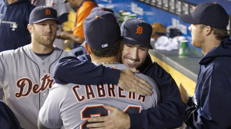 Detroit Tigers' Miguel Cabrera (24) is hugged by Justin Verlander during the fourth inning of a baseball game against the Kansas City Royals at Kauffman Stadium in Kansas City, Mo., Wednesday, Oct. 3, 2012. (AP Photo/Orlin Wagner)