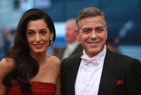 "U.S. actor Clooney arrives with his wife Amal for the Metropolitan Museum of Art Costume Institute Gala 2015 celebrating the opening of ""China: Through the Looking Glass,"" in Manhattan"