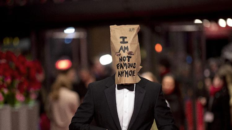 Actor Shia LaBeouf poses for photographers, with a paper bag over his head that says 'I am not famous anymore' on the red carpet for the film Nymphomaniac at the International Film Festival Berlinale in Berlin, Sunday, Feb. 9, 2014. (AP Photo/Axel Schmidt)