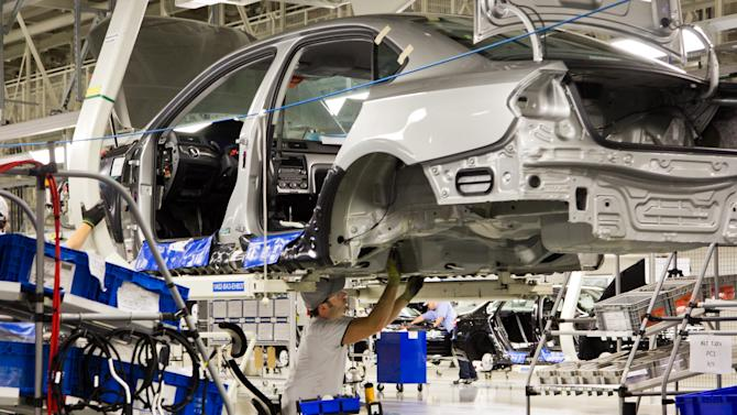 In this July 31, 2012, photo, an employee at the Volkswagen plant in Chattanooga, Tenn., works on a Passat sedan. Martin Winterkorn, the German automaker's CEO, said on Tuesday, Oct. 23, 2012, that Volkswagen is considering the production of a new midsize SUV for the North American market, and that the Tennessee facility would be in the running to make the model. (AP Photo/Erik Schelzig)