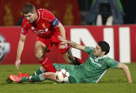 Gerrard of Liverpool challenges Abalo of Ludogorets during their Champions League soccer match in Sofia
