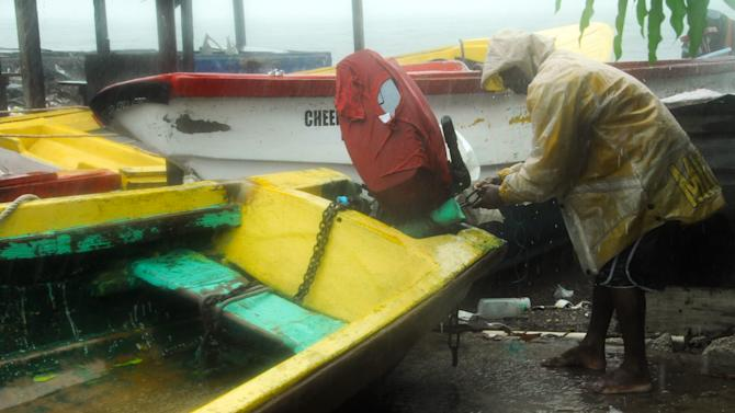 Fisherman Hubert Dowie works to secure his boat before the arrival of Hurricane Sandy in Port Royal, Jamaica, Wednesday, Oct. 24, 2012.  Hurricane Sandy pounded Jamaica with heavy rain as it headed for landfall near the country's most populous city on a track that would carry it across the Caribbean island to Cuba, and a possible threat to Florida. (AP Photo/Collin Reid)