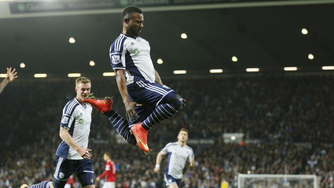 Stephane Sessegnon of West Bromwich Albion celebrates scoring his team's first goal against Manchester United during their English Premier League soccer match at The Hawthorns in West Bromwich