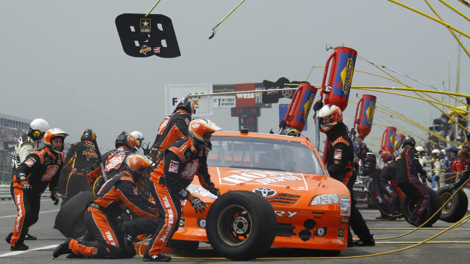 Joey Logano pits during the NASCAR Sprint Cup Series auto race on Sunday, Aug. 7, 2011, at Pocono Raceway in Long Pond, Pa. (AP Photo/Matt Slocum)
