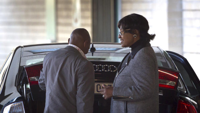 Ex-wife of Nelson Mandela Winnie Madikizela-Mandela, right, leaves after visiting the Mediclinic Heart Hospital where the former South African President is being treated in Pretoria, South Africa Sunday, June 16, 2013. South Africa's president says that Nelson Mandela is seeing sustained improvement from the recurring lung infection that is forcing him to spend a ninth day in the hospital. (AP Photo/Ben Curtis)