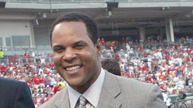 FILE - In this July 19, 2008 file photo, Cincinnati Reds' Hall of Fame 2008 inductee Barry Larkin holds up his plaque after ceremonies before a Reds and New York Mets baseball game in Cincinnati. Larkin has been elected to baseball's Hall of Fame. The shortstop received 86 percent of the vote in balloting announced Monday, Jan. 9, 2012 by the Baseball Writers' Association of America. (AP Photo/ Tony Tribble, File)