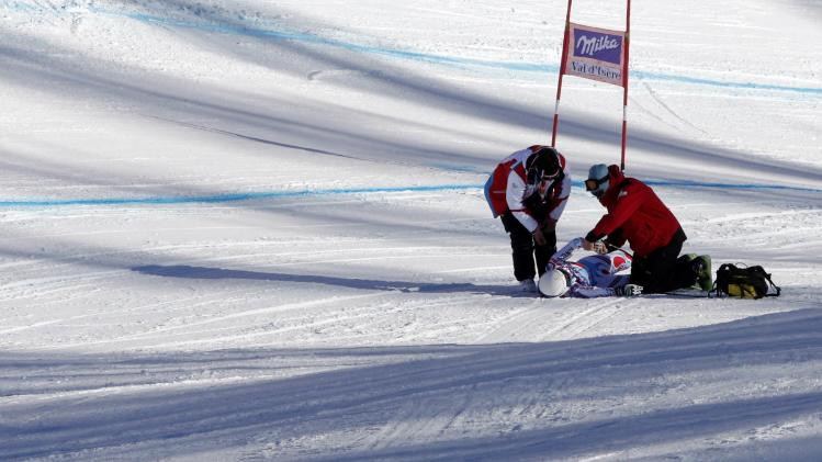 France's Marchand-Arvier receives assistance after crashing during the Women's World Cup Downhill skiing race in Val d'Isere