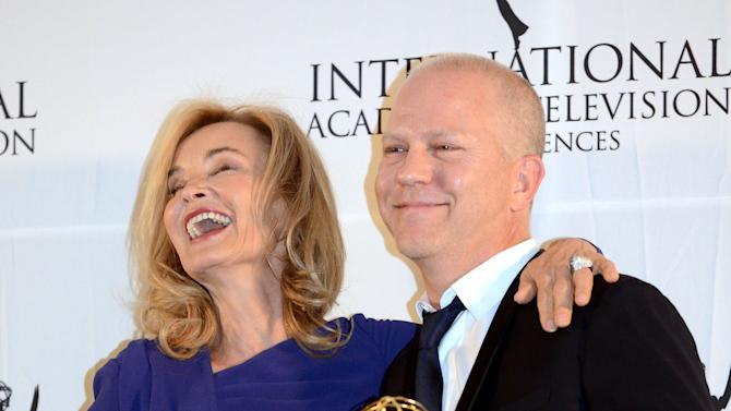 Ryan Murphy, right, poses with presenter Jessica Lange after winning the Founders Award at the 40th International Emmy Awards,  Monday, Nov. 19, 2012 in New York. (AP Photo/Henny Ray Abrams)