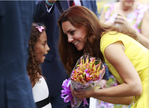 Britain's Kate, the Duchess of Cambridge, talks to a girl during the opening ceremony of the renovated Commonwealth Street in central Honiara, Solomon Islands, Monday, Sept. 17, 2012. Prince William,