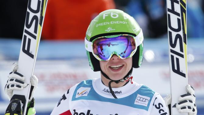 Schmidhofer of Austria reacts after finishing her run in women's Alpine Skiing World Cup Super-G in St. Moritz