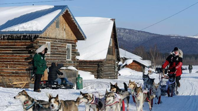 Aliy Zirkle arrives at the Kaltag checkpoint of the Iditarod Trail Sled Dog Race on Saturday, March 10, 2012 in Kaltag, Alaska. (AP Photo/The Anchorage Daily News, Marc Lester)