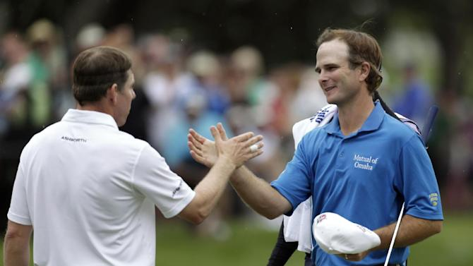 Kevin Streelman, right, shakes hands with Justin Leonard after Streelman won the Tampa Bay Championship golf tournament Sunday, March 17, 2013, in Palm Harbor, Fla. (AP Photo/Chris O'Meara)