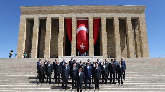 Turkey's Prime Minister Ahmet Davutoglu (C - Front) poses with his ministers on September 1, 2015 after a wreath-laying ceremony at Anitkabir, the mausoleum of modern Turkey's founder Mustafa Kemal Ataturk, in Ankara