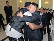 Kim Jong-Un (R) hugs Dennis Rodman before a dinner in Pyongyang, on February 28, 2013. The Swiss-educated Kim is reported to be a huge fan of basketball and the Chicago Bulls, with whom Rodman won three NBA titles alongside Michael Jordan in the 1990s