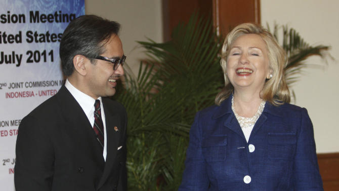 U.S. Secretary of State Hillary Rodham Clinton, right, shares a light moment with Indonesian Foreign Minister Marty Natalegawa at the Joint Commission Meeting Indonesia-U.S. in Nusa Dua, Bali, Indonesia, Sunday, July 24, 2011.  (AP Photo/Dita Alangkara)