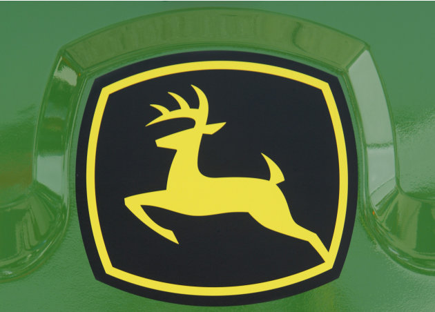 In this Aug. 31, 2011 photo, the John Deere logo is seen on the back of a combine at the John Deere farming equipment exhibit area during the Farm Progress Show in Decatur, Ill. A slowing global econo