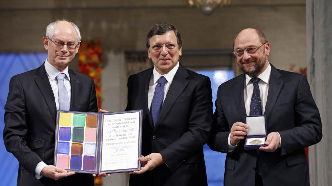 """From left, European Council President Herman Van Rompuy, European Commission President Jose Manuel Barroso and European Parliament President Martin Schulz with the Nobel diploma on the podium at the City Hall, Oslo, during the Nobel Peace Prize ceremony, Monday Dec. 10, 2012. The European Union has received this yearís Nobel Peace Prize in the Norwegian capital, for promoting """"peace and reconciliation, democracy and human rights"""" in Europe for six decades following the tremendous devastation of World War II. (AP Photo/Cornelius Poppe/NTB Scanpix, Pool)"""