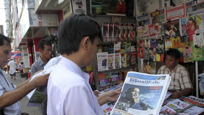 A man looks at a local weekly journal reporting U.S. President Barack Obama, at a stall Friday, Nov. 16, 2012, in Yangon, Myanmar. Obama will visit Myanmar on Monday, becoming the first U.S. president to visit the once pariah nation. (AP Photo/Khin Maung Win)
