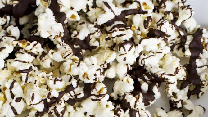 In this image taken on Jan. 28, 2013, Stovetop Popcorn Many Ways with melted chocolate is shown in Concord, N.H. (AP Photo/Matthew Mead)