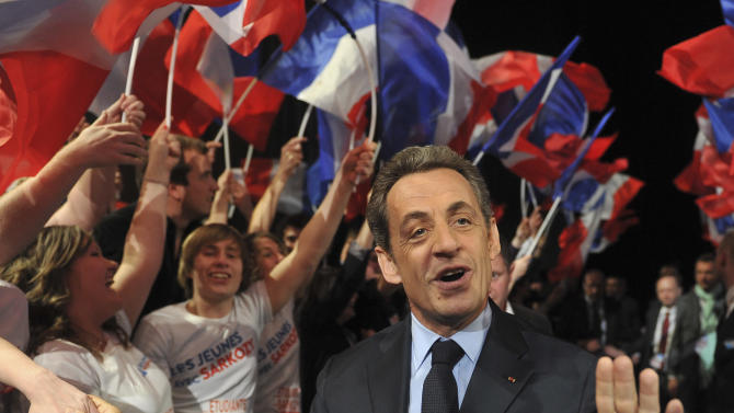 French incumbent President and Union for a Popular Movement (UMP) candidate for the French 2012 presidential elections Nicolas Sarkozy arrives at a meeting campaign in Nancy, eastern France, Monday, April 2, 2012. (AP Photo/Christophe Guibbaud, Pool)