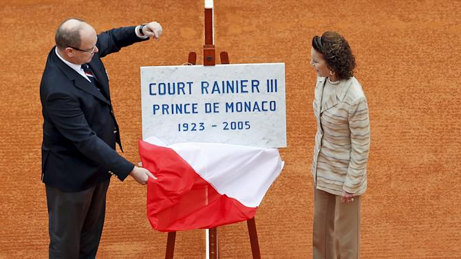 Prince Albert II of Monaco and his cousin Elisabeth-Anne de Massy unveil a plaque to pay tribute to late Prince Rainier III of Monaco who died 10 years ago, before the final tennis match at the Monte Carlo Masters in Monaco