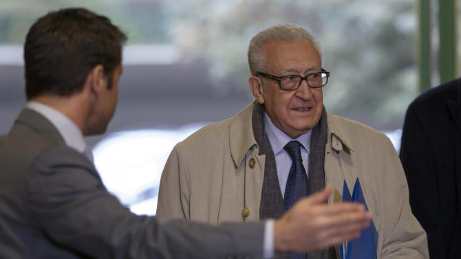 The UN Joint Special Representative for Syria, Lakhdar Brahimi, right, arrives for a meeting with Russian deputy foreign minister Mikhail Bogdanov and US Deputy Secretary of State William Burns, both unseen, to find a politic solution for the crisis in Syria, at the European headquarters of the United Nations, in Geneva, Switzerland, Friday, Jan. 11, 2013. AP Photo/Keystone, Salvatore Di Nolfi)