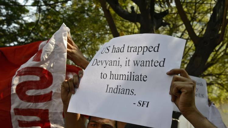 A member of SFI holds up a poster while shouting slogans during a protest outside the U.S. consulate office in Hyderabad