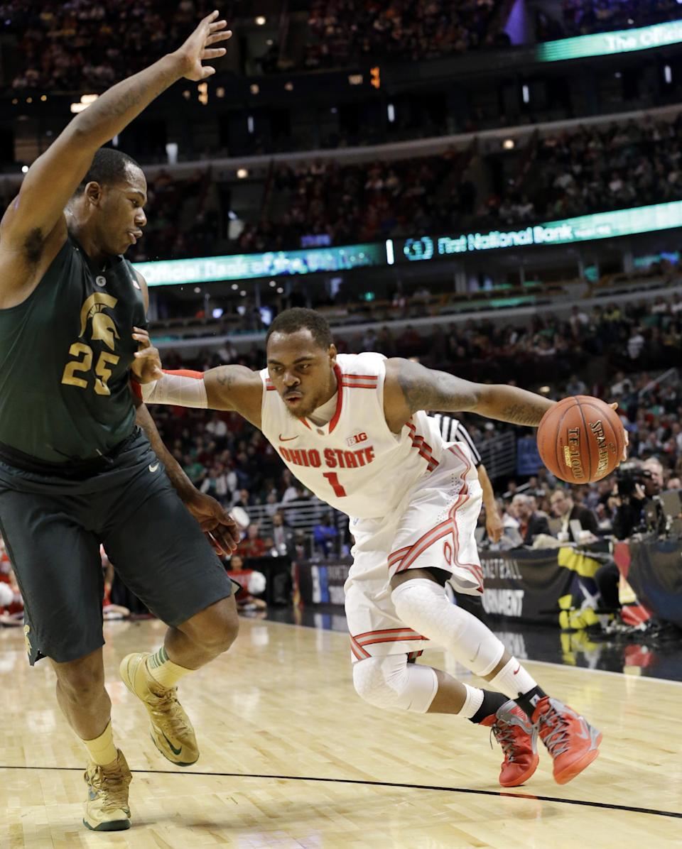 Ohio State's Deshaun Thomas (1) tries to drive past Michigan State's Derrick Nix (25) during the first half of an NCAA college basketball game at the Big Ten tournament Saturday, March 16, 2013, in Chicago. (AP Photo/Nam Y. Huh)