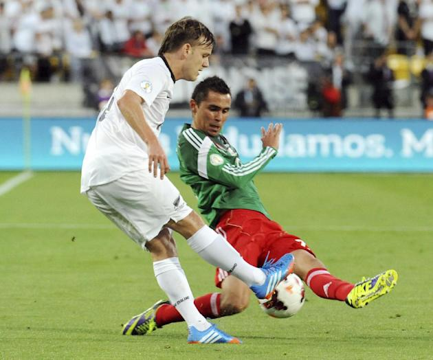 Mexico's Paul Aguilar, right, vies for the ball with New Zealand's Chris James during their World Cup qualifying soccer match at Westpac Stadium, in Wellington, New Zealand, Wednesday, Nov. 20, 2013.