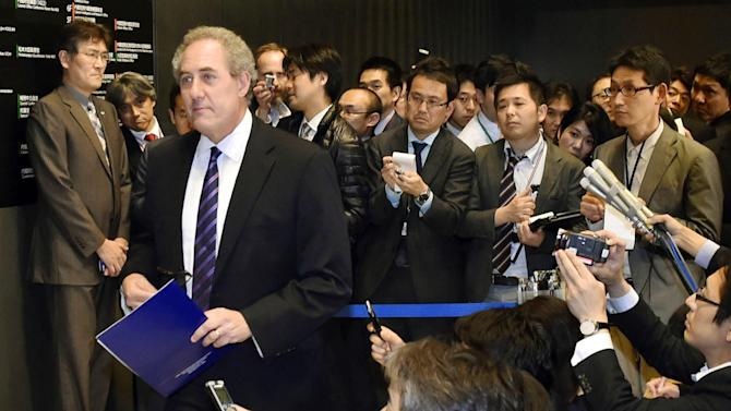 U.S. Trade Representative Michael Froman, front left, leaves after talks with Japanese counterpart in Tokyo early Tuesday, April 21, 2015. The U.S. and Japan need further work to resolve differences on autos and farm exports that are hindering progress toward a Pacific Rim trade deal, Froman said Tuesday. (Shigeyuki Inakuma/Kyodo News via AP) JAPAN OUT, MANDATORY CREDIT