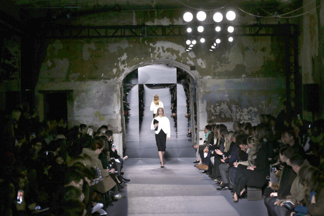 In this Feb. 13, 2013, the Proenza Schouler Fall 2013 collection is modeled at 5 Beekman Street in lower Manhattan during Fashion Week in New York. In the appropriately spectacular venue of a long shuttered, 19th-century building said to have been the first high-rise in New York City — in the dark, the walls looked like something from an ancient ruin — the designers displayed a restrained color palette of white, black and subtle pastels like mint and peach, enabling them to place the focus squarely on the beautiful fabrics. (AP Photo/Seth Wenig)