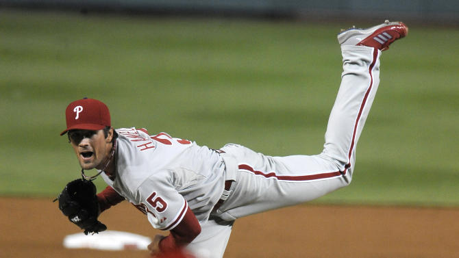 Philadelphia Phillies' starting pitcher Cole Hamels delivers pitch to Washington Nationals' batter Jordan Zimmermann during second inning of their baseball game at Nationals Park, Sunday, May 6, 2012, in Washington. (AP Photo/Richard Lipski)