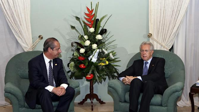 Maltese Prime Minister Lawrence Gonzi, left, and Italian Premier Mario Monti talk during a bilateral meeting at a Mediterranean summit of southern European and North African countries, in Valletta, Malta, Friday, Oct. 5, 2012.  The Malta summit of five European and five African nations is expected to focus on fighting terrorism and lawlessness in North African as well as France's push for a military intervention in Mali, where Islamist rebels have taken control in the north. (AP Photo/Andrew Medichini)