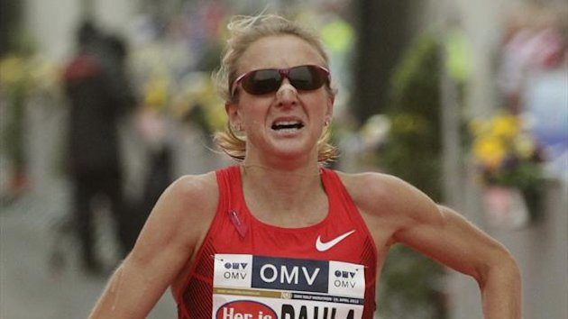 Paula Radcliffe of the UK reacts after running the half marathon race during the Vienna City Marathon in Vienna April 15, 2012.