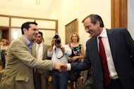 "<p>Leader of the New Democracy conservative party Antonis Samaras (right) greets the head of Greece's radical left-wing Syriza party Alexis Tsipras, at the Greek parliament in Athens on Monday. Samaras, who came first in the June 17 national election, said he will meet with leaders of all parties ""that believe in Greece's European orientation and the euro"" in order to form a coalition government.</p>"
