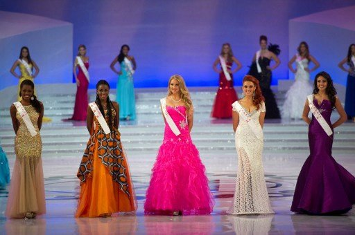 (From-L) Miss Gabon Marie Noelle Ada Meyo, Miss Cote d'Ivoire Hadjau Helene-Valerie, Miss Finland Sabina Sarkka, Miss France Delphine Wespiser and Miss Colombia Barbara Turbay pose during the Miss