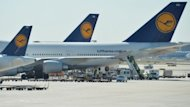 Lufthansa planes are parked on the tarmac at the Frankfurt am Main Airport. Lufthansa made a key concession in talks with unions on Friday, and both sides agreed to a mediator, as a 24-hour walkout that grounded half the airline's flights in Germany entered its final hours