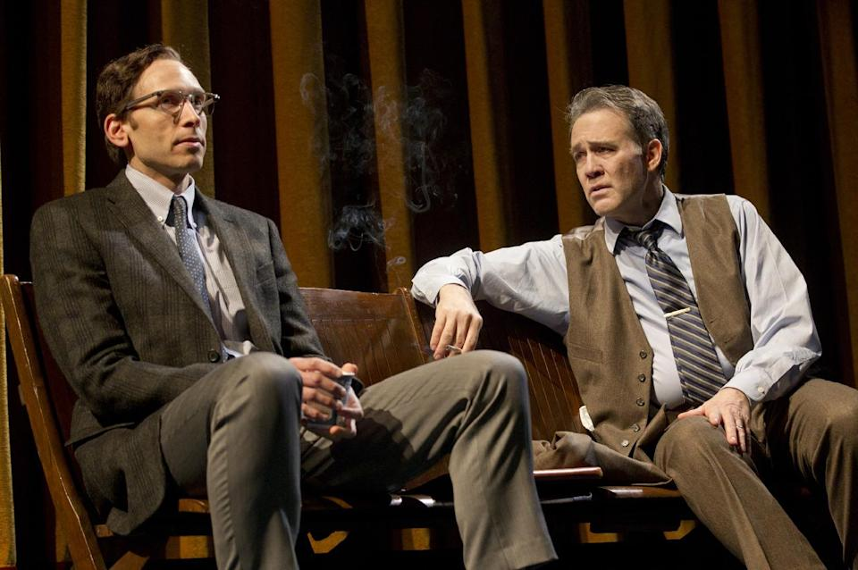 "In this theater image released by Boneau/Bryan-Brown, Stephen Kunken portrays David Halberstam, left, and Boyd Gaines portrays Stewart Alsop in a scene from the play ""The Columnist,"" playing at the Samuel J. Friedman Theatre in New York. (AP Photo/Boneau/Bryan-Brown, Joan Marcus)"