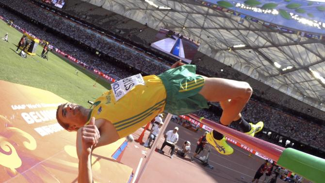 Starc of Australia competes in the men's high jump qualifying round during the 15th IAAF World Championships at the National Stadium in Beijing
