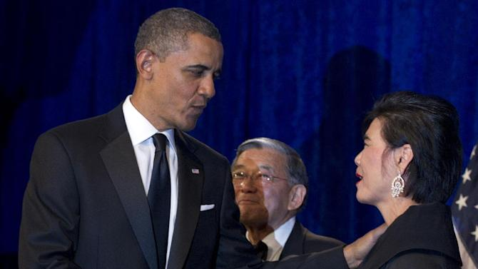 President Barack Obama shakes hands with Rep. Judy Chu, D-Calif., as former Transportation Secretary Norman Mineta watches as he arrives to deliver the keynote address at the Asian Pacific American Institute for Congressional Studies dinner Tuesday, May 8, 2012, in Washington. (AP Photo/Carolyn Kaster)